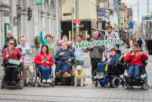 Group photo of people with disabilites promoting MakeWayDay with a sign