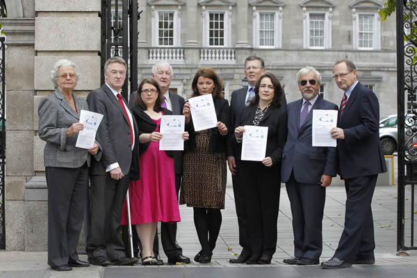 "Dublin Thursday 15th September 2011: Judy Windell (left) with John Dolan, Denise Dunne, Tom King, Natalie Buhl, Morgan McKnight, Deirdre Carroll, Des Kenny and Maurice O'Carroll, members of ten national organisations representing 800,000 people with disabilities, pictured here issuing a joint statement to Government entitled ""Preventing the Collapse of Ireland's Disability Strategy"". It deals with the cumulative effect of reductions in essential income and service supports on people with disabilities, including mental health, since the onset of the recession in 2008. Picture Jason Clarke Photography."